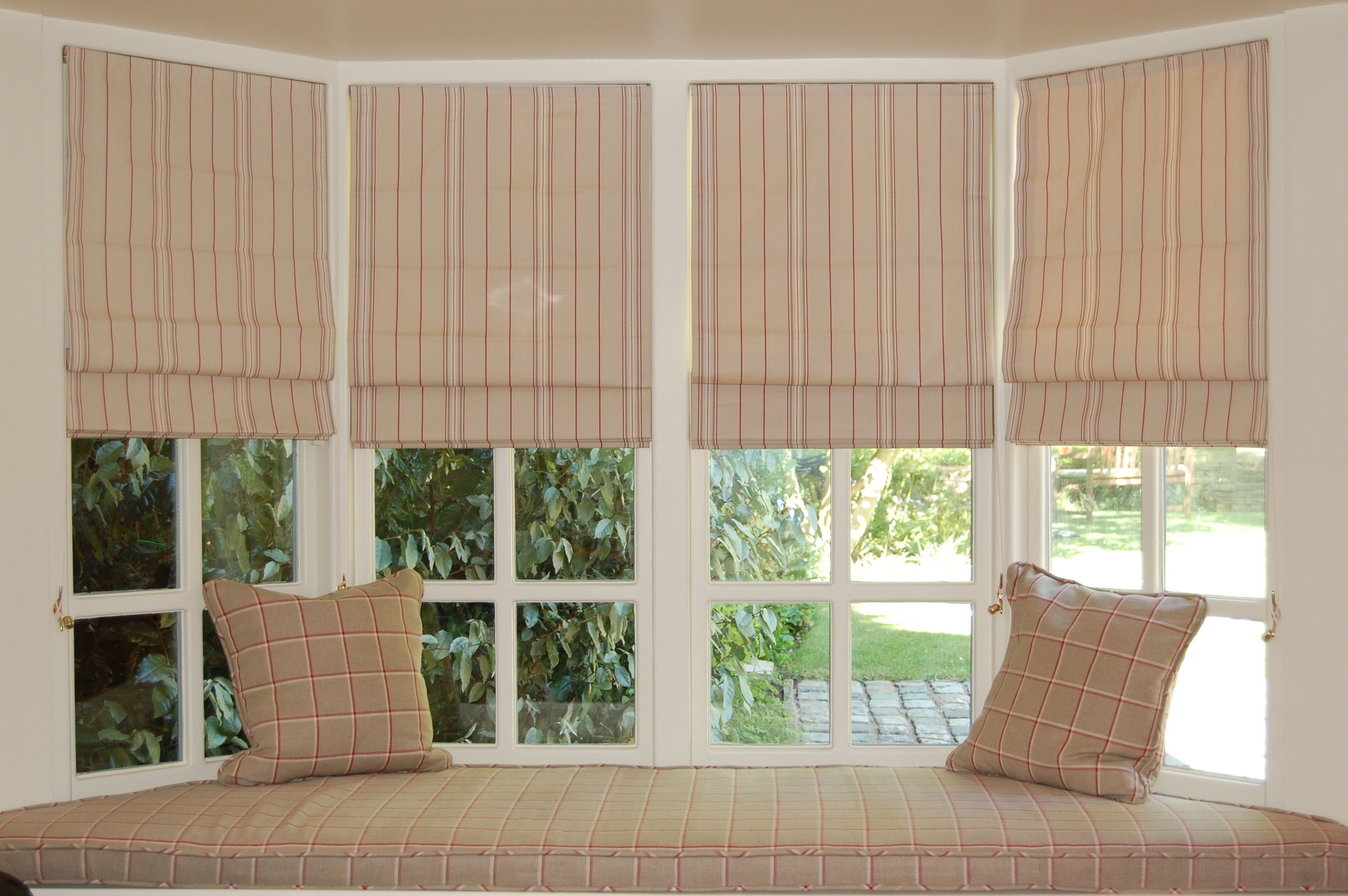 Diana murray interiors blinds and window seat in family for Roman shades for bay window