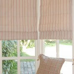 Photo of roman blinds in a garden room bay window