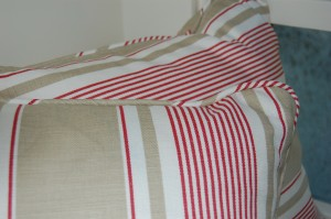 Cushions can be made in fabric to match curtains, blinds or other furnishings in your scheme.