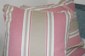 Piped cushion in French Ticking
