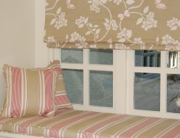 Bedroom with roman blinds and window seat