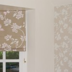 Photo of roman blind and matching wallpaper in a floral design.