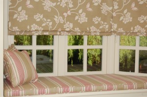 Two roman blinds and bespoke cushion to fit the window seat.