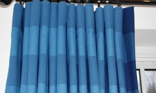 Close up of cartridge pleat in denim check fabric.