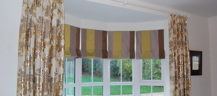 Bow window with roman blinds and dress curtains
