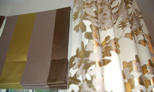 Photo showing close up shot of roman blind and curtain
