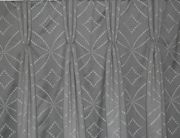 Full length triple pleat curtains in master bedroom