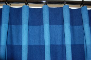 The spaces between the pleats are only seen when the curtain is drawn.